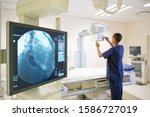 Male Radiographer Working In...