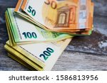pile of fifty  hundred and two... | Shutterstock . vector #1586813956