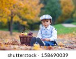 boy in a park with leaves and... | Shutterstock . vector #158690039