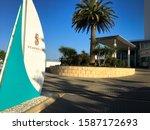 Small photo of Mandurah, WA / Australia - December 11, 2019: Seashells Resort reception inroad near Dolphin Quay with blue sky on an early summer morning