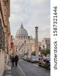 Small photo of People walking towards St. Peter's Basilica in Rome via via della Conciliazione 11/02/2015
