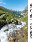 Rapid water streams coming down to the valley close to Grand Col Ferret, in the Italian Alps, Val Ferret, on the Tour de Mont-Blanc trail - stock photo