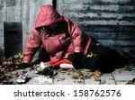 A Woman Lying Against A Brick...