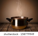 cooking pot on old wooden table | Shutterstock . vector #158779949