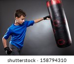 Boy Hitting The Punching Bag On ...