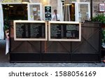 Small photo of ROME, Italy - Jun 2015: Restaurant with menu shown up on fence