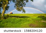 Summer rural house rainbow...