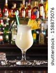 pina colada cocktail on a bar... | Shutterstock . vector #158875076