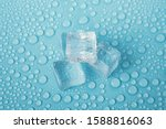 Ice Cube On Water Drops...