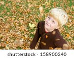 a cute  smiling young boy is... | Shutterstock . vector #158900240