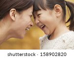 mother and daughter face to face | Shutterstock . vector #158902820