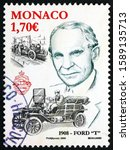 Small photo of ZAGREB, CROATIA - NOVEMBER 24, 2019: a stamp printed in Monaco shows Henry Ford (1863-1947), American industrialist and Ford model T, circa 2008