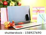 laptop with gifts on table on... | Shutterstock . vector #158927690