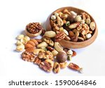 Mix Nuts In Wooden Plate Pour...