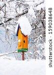 Orange Birdhouse In Winter...