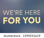 Small photo of Slogan words we're here for you saying quote words to live by. Text, note