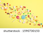 candies and sweets on a colored ... | Shutterstock . vector #1590730153