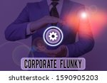Small photo of Text sign showing Corporate Flunky. Conceptual photo someone who works obediently for another demonstrating in company.