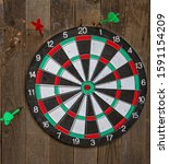 darts target hanging on an old... | Shutterstock . vector #1591154209