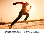 Athletic  Man Running In Winte...