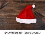 christmas santa hat on wood | Shutterstock . vector #159129380
