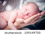 Newborn Baby Sleeping On The...