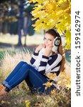 smiling girl outside in... | Shutterstock . vector #159162974