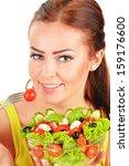 Young woman eating vegetable salad - stock photo