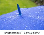 Rain Drops On Blue Umbrella