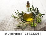 Olive Oil And Olive Branch On...