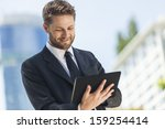 a smart young businessman with... | Shutterstock . vector #159254414