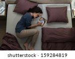 young mourning woman lying in... | Shutterstock . vector #159284819
