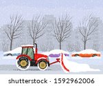 A Tractor Cleans The Road In...