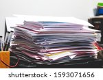 Small photo of Pile of unorganized document placed on desk