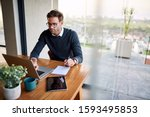 Young Businessman Sitting At A...