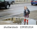 Adorable Girl Standing In A...