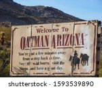 "Small photo of Oatman, Arizona - may 2014 : Old decrepit road sign ""Welcome to Oatman Arizona"""