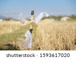 used plastic bag tied to high... | Shutterstock . vector #1593617020