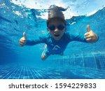 Kid Having Fun At Pool...