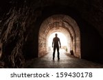 Young Man Stands In Dark...