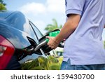 hand refilling the car with... | Shutterstock . vector #159430700