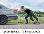 Two Girls Pushing Their Car...