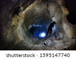 Speleologist Descend By The...