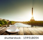 coffee on table and eiffel... | Shutterstock . vector #159518054