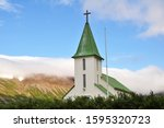 Church Surrounded By Mountains...