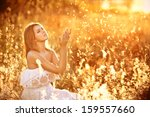 a girl sits in a white sundress ... | Shutterstock . vector #159557660