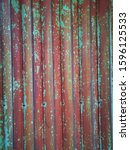 Small photo of beautiful old green and red vintage iron curtain for industrial loft style