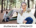 man pitching the tent while... | Shutterstock . vector #159626423