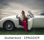 Beautiful Woman On A Vintage Car