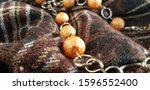 Round Orange Beads In Folds Of...